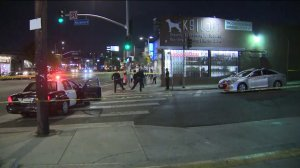 Police investigate after three people were shot at Sunset Boulevard and Rosemont Avenue in Echo Park on Sept. 13, 2019. (Credit: KTLA)