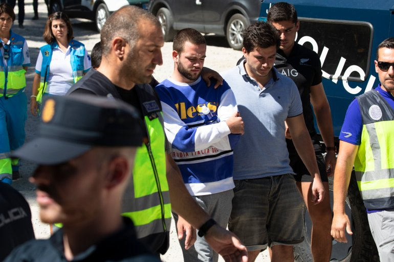 David Fresneda, center, son of Spanish winter Olympic medallist Blanca Fernandez Ochoa, is comforted as he walks along the search coordination center in Las Dehesas, Spain, on Sept. 4, 2019. (Credit: Pablo Blazquez Dominguez / Getty Images)