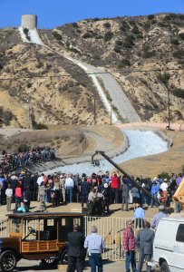 A crowd gathers in Sylmar on the 100th anniversary of the opening of the Los Angeles Aqueduct gates opening, on Nov. 5, 2013.(Credit: Frederic J. Brown/AFP/Getty Images)