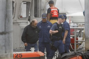 A crew member rescued from a dive boat that burned off Santa Cruz Island is brought back to the U.S. Coast Guard headquarters at Channel Islands Harbor in Oxnard on Sept. 2, 2019. (Credit: Carolyn Cole/Los Angeles Times)