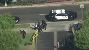 Los Angeles County Sheriff's vehicles remained at Paramount High School hours after a fight broke out on campus on Sept. 20, 2019. (Credit: KTLA)