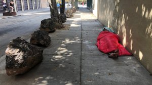 Neighbors organized efforts to use boulders to stop the homeless from pitching tents on their sidewalks. (Credit: Dan Simon/CNN)
