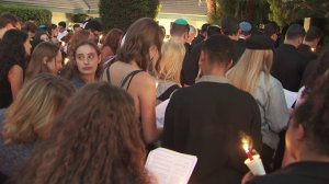 Mourners gather at Cal State University Northridge on Sept. 12, 2019, for a vigil for student Michael Lertzman, 19, who was shot to death in a double-murder suicide at his family's home in Northridge on Sept. 11, 2019. (Credit: KTLA)