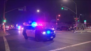 Authorities investigate the scene of a hi-and-run collision that left one pedestrian dead and another injured in the Westmont neighborhood of South Los Angeles on Sept. 24, 2019. (Credit: KTLA)