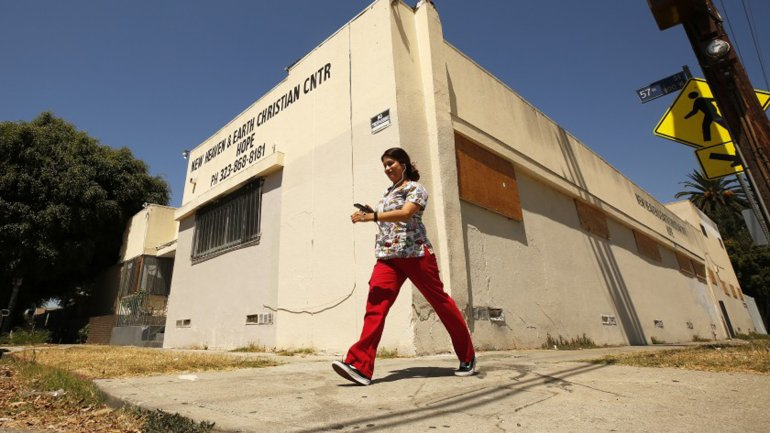 An old church building at 805 W. 57th St. was illegally converted into residential space. LAPD officers ordered residents to evacuate in 2018.(Credit: Al Seib / Los Angeles Times)