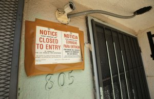 A city notice is posted on the illegally converted church building in the 800 block of West 57th Street.(Credit: Al Seib / Los Angeles Times)