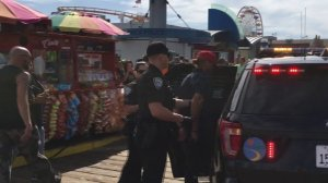 Officers responding to a pepper spray incident at Santa Monica Pier take a man into custody on Oct. 20, 2019. (Credit: KTLA)