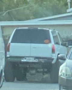 Police are searching for a white Chevy Tahoe with license plate 3RSR716.