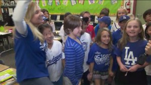 Holly Lang, far left, and her students, root on the Dodgers from their classroom on Oct. 3, 2019. (Credit: KTLA)