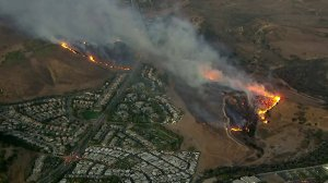 A brush fire is seen burning in Simi Valley on Oct. 30, 2019. (Credit: KTLA)