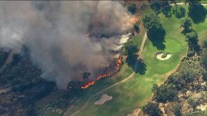 The Getty Fire burns near the Mountain Gate Golf Course on Oct. 28, 2019. (Credit: KTLA)