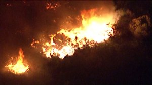 Flames rage near Fullerton homes on Oct. 30, 2019. (Credit: KTLA)