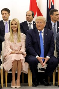 """Advisor to the U.S. President Ivanka Trump sits with her father U.S. President Donald Trump during an event on the theme """"Promoting the place of women at work"""" on the sidelines of the G20 Summit in Osaka, Japan, on June 29, 2019. (Credit: DOMINIQUE JACOVIDES/AFP/Getty Images)"""