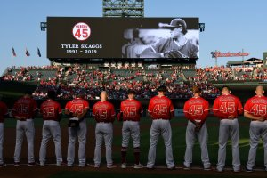 The Los Angeles Angels of Anaheim stand for a moment of silence before they play the Seattle Mariners at Angel Stadium of Anaheim on July 12, 2019 in Anaheim. (Credit: John McCoy/Getty Images)