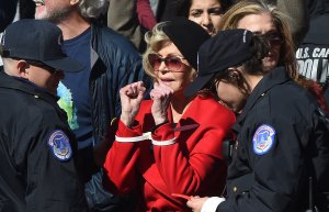 "Actress Jane Fonda is arrested for blocking a street in front of the U.S. Capitol during a ""Fire Drill Fridays"" climate change rally on Oct. 18, 2019. (Credit: Mark Wilson / Getty Images)"