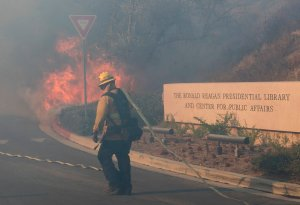 Firefighters battle to protect the Reagan Library from the Easy Fire in Simi Valley on Oct. 30, 2019. (Credit: MARK RALSTON/AFP via Getty Images)
