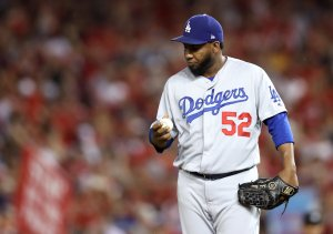 Pedro Baez of the Los Angeles Dodgers reacts after giving up a three-run home run to Ryan Zimmerman of the Washington Nationals in the fifth inning of Game 4 of the National League Division Series at Nationals Park in Washington, D.C., on Oct. 7, 2019. (Credit: Rob Carr / Getty Images)