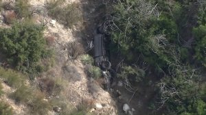 The vehicle of a Glendale assault suspect is seen after it was discovered off the side of a road in Angeles National Forest on Sept. 26, 2019. (Credit: KTLA)