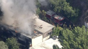 Firefighters respond to a blaze at a home in the Hollywood Hills on Oct. 4, 2019. (Credit: KTLA)