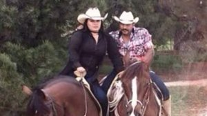 A married couple were struck and critically injured, and their horses were killed, in a hit-and-run in Lake View Terrace on Oct. 25, 2019. They are pictured in a photo included on a fundraising website.