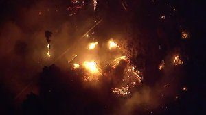 A home is seen in flames as the Maria Fire tears through communities near Santa Paula and Somis in Ventura County on Oct. 31, 2019. (Credit: KTLA)
