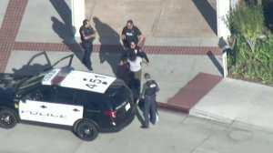 A woman is detained on the Cal State Long Beach campus after a credible threat was made against the school on Oct. 7, 2019. (Credit: KTLA)
