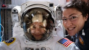 NASA astronaut Christina Koch (right) poses for a portrait with fellow Expedition 61 Flight Engineer Jessica Meir of NASA who is inside a U.S. spacesuit for a fit check in this undated photo provided by the agency.