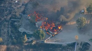A large home in the Canyon Country area burns during the Tick Fire on Oct. 24, 2019. (Credit: KTLA)