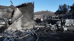 A structure and vehicle stand scorched by the Tick Fire on October 25, 2019 in Canyon Country, California. (Credit: Mario Tama/Getty Images)