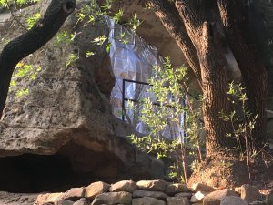 A fire blanket covers a small sandstone cave at Chumash Painted Cave State Historic Park in Santa Barbara as the Cave Fire burns nearby on Nov. 26, 2019. (Credit: California State Parks)
