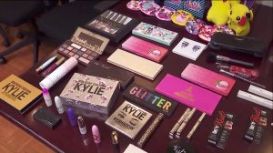 Counterfeit makeup found by L.A. City officials is displayed during a news conference on Nov. 26, 2019. (Credit: KTLA)