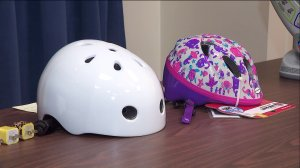 A helmet that has been recalled and officials say continued to be sold by Walmart is displayed during a news conference on Nov. 26, 2019. (Credit: KTLA)