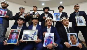 """People attend a press conference in Bishkek, Kyrgyzstan on Nov. 29, 2018 holding portraits of their relatives they fear are being held in """"reeducation camps"""" in China's Xinjiang region. (Credit: VYACHESLAV OSELEDKO/AFP via Getty Images)"""