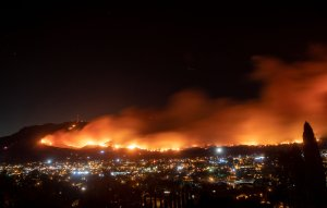 A long exposure photo shows the Maria Fire as it races across a hillside in Santa Paula on Nov. 1, 2019. (Credit: Josh Edelson / AFP via Getty Images)