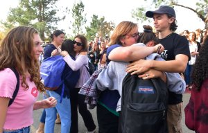 Grieving students from Saugus High School reunite with their parents at Central Park in Santa Clarita after a fatal school shooting on Nov. 14, 2019. (Credit: Frederic J. Brown / AFP / Getty Images)