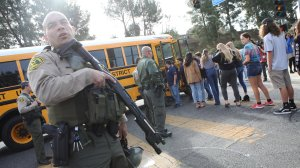 Students evacuate from Saugus High School onto a school bus after a shooting at the school left two students dead and three wounded on Nov. 14, 2019, in Santa Clarita. (Credit: Mario Tama/Getty Images)