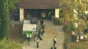 Authorities search for evidence after serving a warrant at the home of the suspected Saugus High School shooter in Santa Clarita on Nov. 14, 2019. (Credit: KTLA)