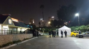 Los Angeles Police Department officers investigate a fatal stabbing at Grand Avenue and Cesar E. Chavez Avenue in downtown Los Angeles on Nov. 15, 2019. (Credit: KTLA)