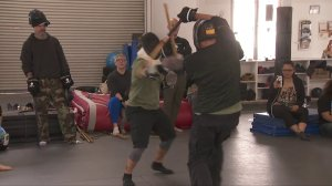 Martial artists battle it out while fighting cancer at the same time at the 10th annual Beat the Crap Out of Cancer event at Valley Martial Arts Center in North Hollywood. (Credit: KTLA)