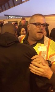 John O'Connor, a supervisor at Bay Area Rapid Transit, hugs a man he pulled from the tracks just as a train was arriving at the station in Oakland, California, on Nov. 3, 2019. (Credit: Tony Badilla/Twitter via CNN)