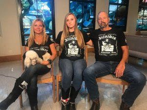 Victoria Rose Meek, center, sits with her mother, Lauren Lynn, and father, Roger in November 2019. (Credit: Paul Vercammen/CNN)