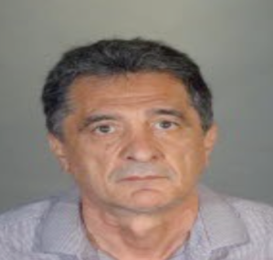 Moossa Lari is seen in an undated booking photo released by the LAPD on Nov. 8, 2019.