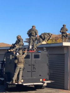Los Angeles County Sheriff's Department special enforcement deputies serve a warrant in search of a murder suspect wanted by the Los Angeles Police Department in Rowland Heights on Nov. 9, 2019. (Credit: LASD)