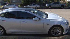 A Tesla believed to be linked to a hit-and-run was recovered in Harvard Heights on Nov. 22, 2019. (Credit: KTLA)
