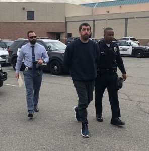 Barstow police released this photo of Brandon Yaag being escorted away in handcuffs by police on Dec. 18, 2019.