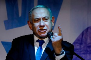 Israeli Prime Minister Benjamin Netanyahu addresses Likud party supporters during an electoral meeting in the Israeli city of Petah Tikva near Tel Aviv on Dec. 18, 2019. (Credit: JACK GUEZ/AFP via Getty Images)