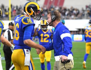 Los Angeles Rams head coach Sean McVay congratulates quarterback Jared Goff after a touchdown in the second half of the game against the Arizona Cardinals at the Memorial Coliseum on Dec. 29, 2019. (Credit: Jayne Kamin-Oncea / Getty Images)