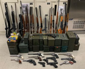 Police seized 33 guns and half a pound of methamphetamine, as well as arrested to convicted felons, during a probation search in Riverside County on Dec. 12, 2019. (Credit: Riverside Police Department)