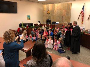 The kindergarten class supported their classmate Michael, as his adoption was finalized. (Credit: Kent County, Michigan via CNN)