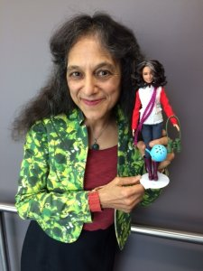 Nalini Nadkarni, a forest ecologist at the University of Utah, poses with her Barbie doppelgänger in 2019. (Credit: Nalini Nadkarni via University of Utah)